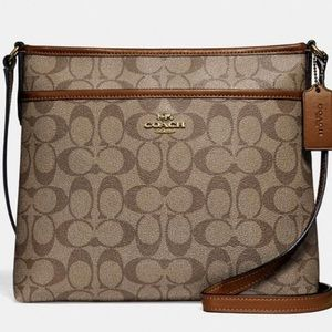 Coach file crossbody in signature canvas.